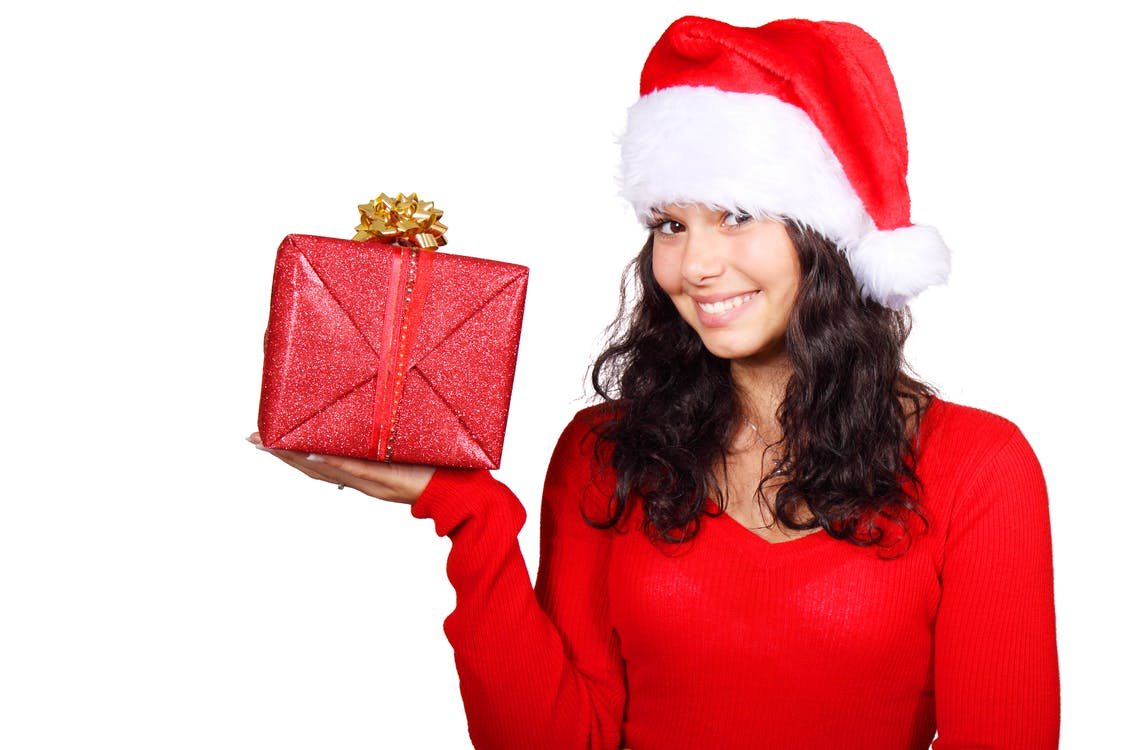 Woman Wearing Santa Dress Holding Red and Gold Gift