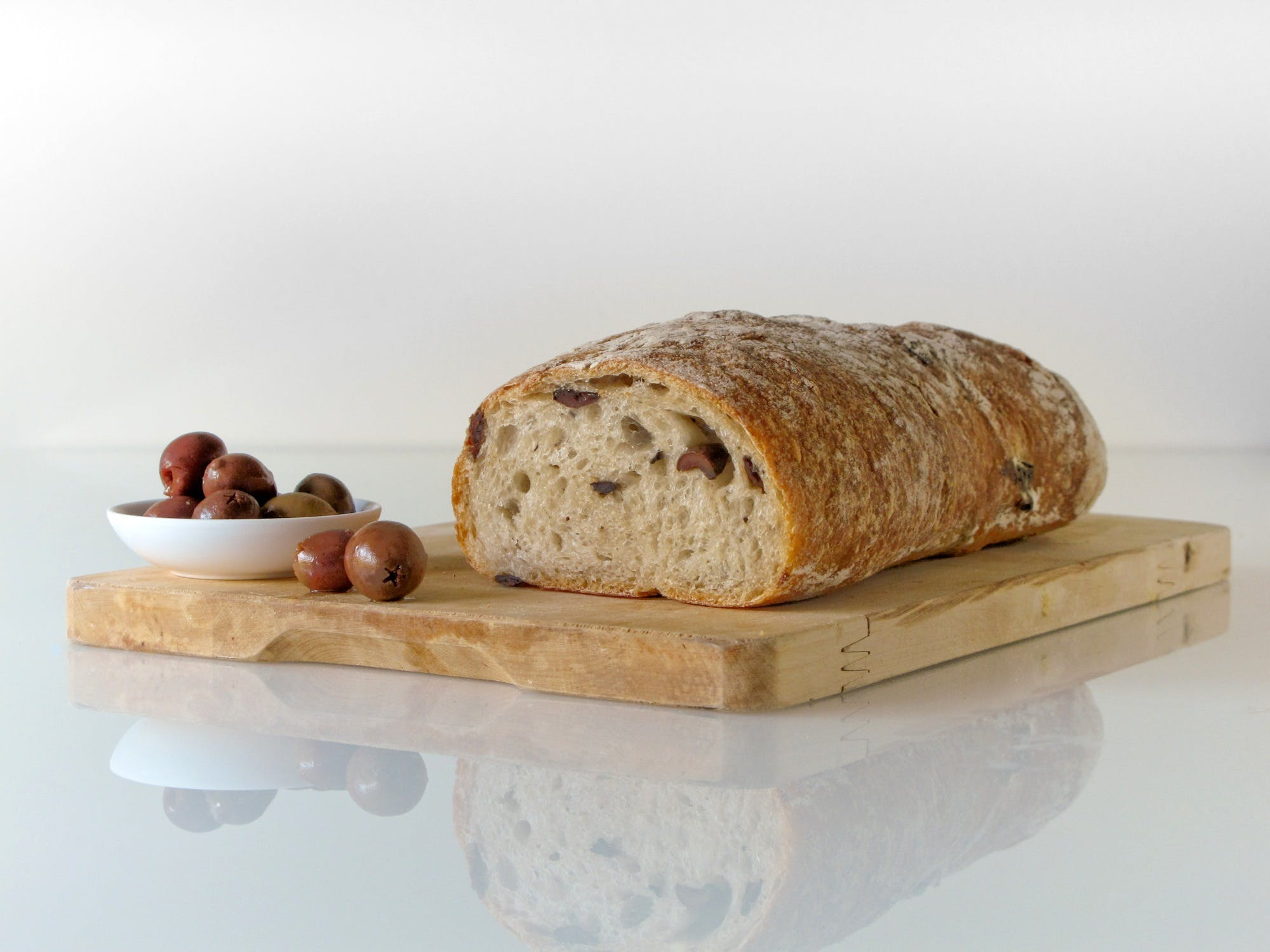 Bread on Top of Brown Wooden Chopping Board