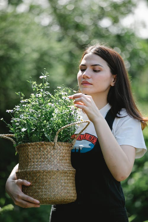 Young woman enjoying fresh smell of wild flowers