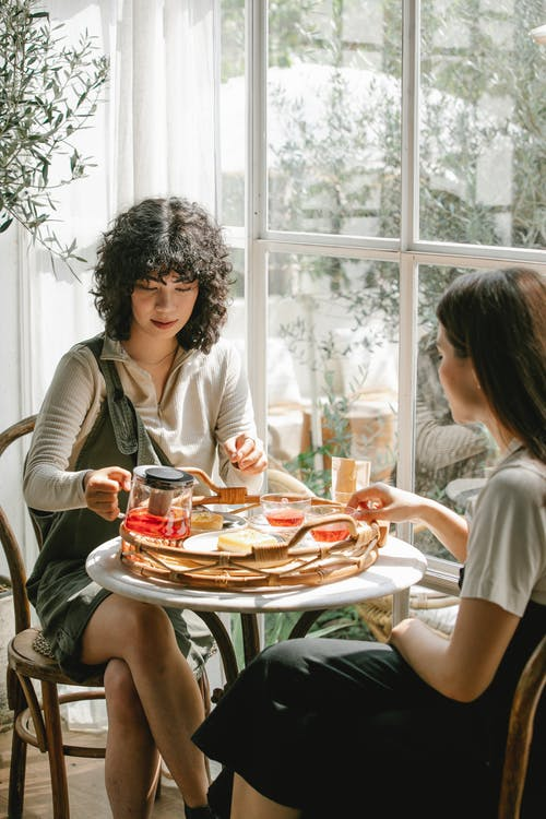 Diverse female colleagues having breakfast together