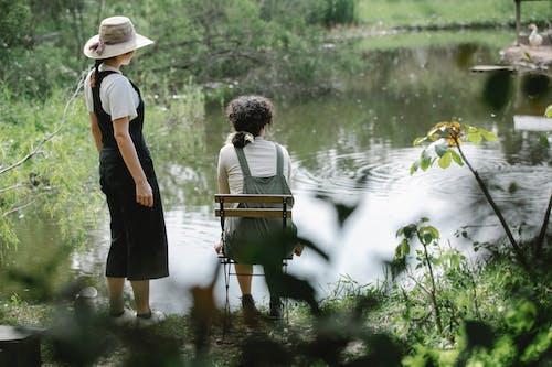 Women enjoying scenery of rippling lake