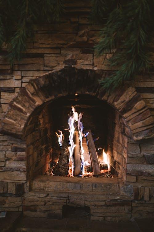 A Close-Up Shot of a Brick Fireplace
