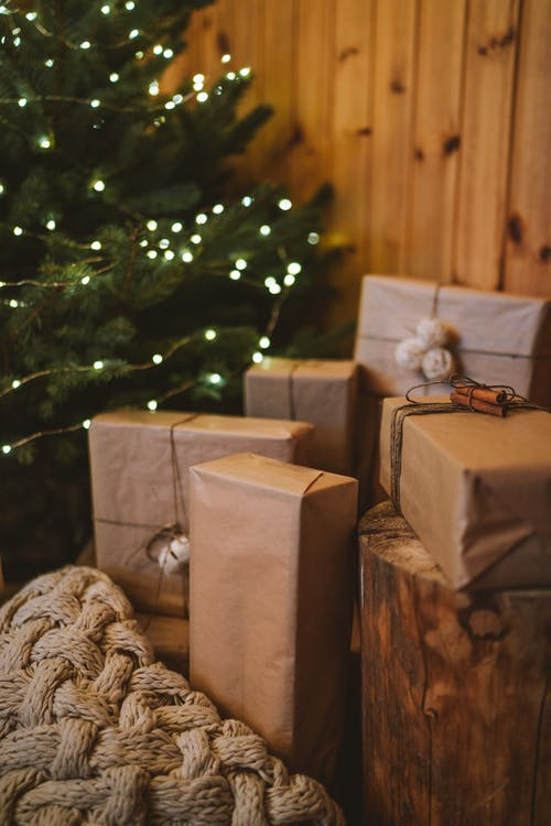 Brown Gift Boxes Beside a Christmas Tree
