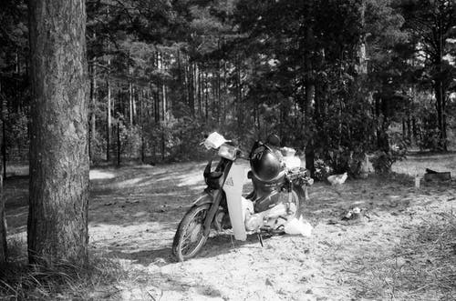 Grayscale Photo of 2 Men Riding Motorcycle