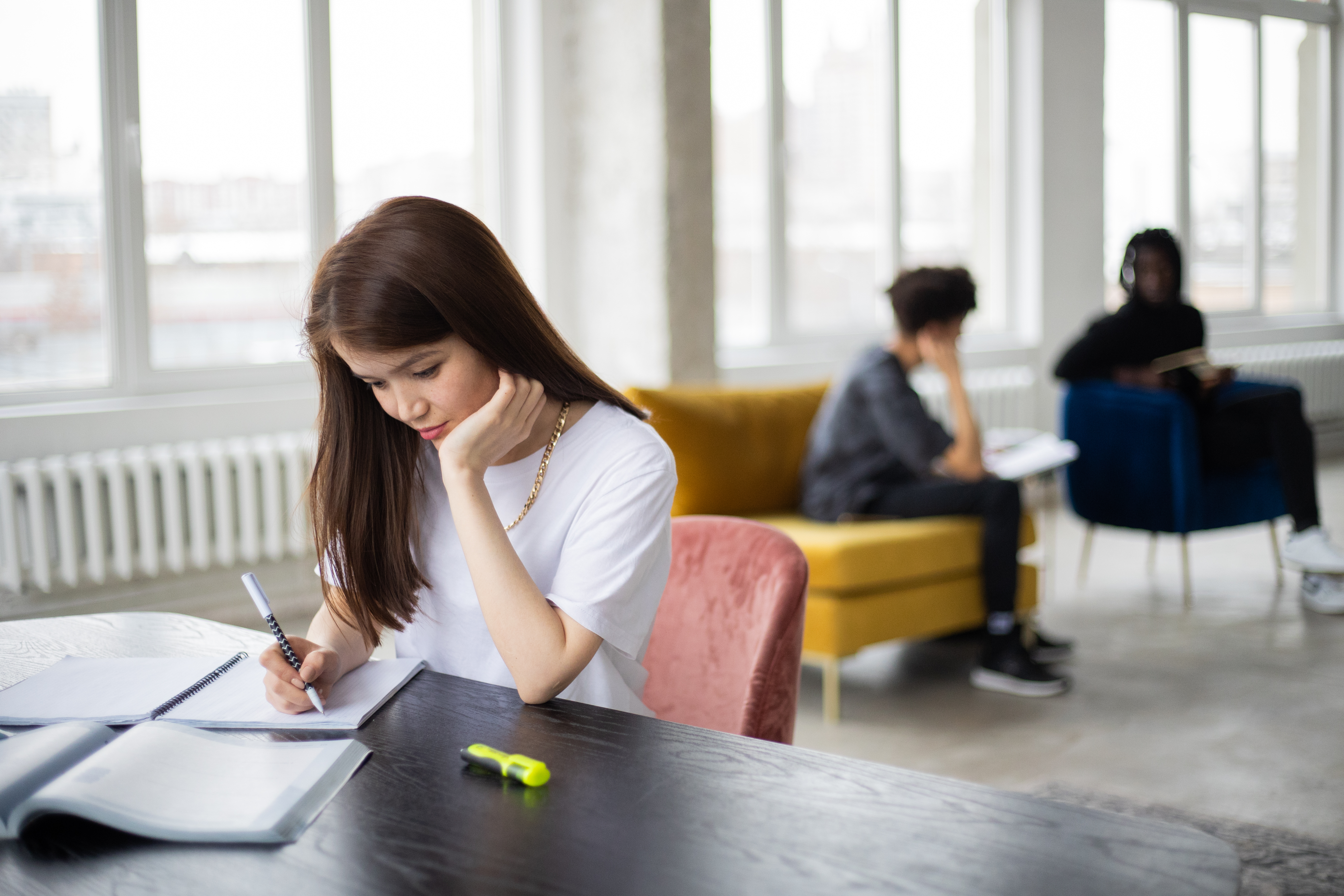 focused woman studying in light workspace in daytime