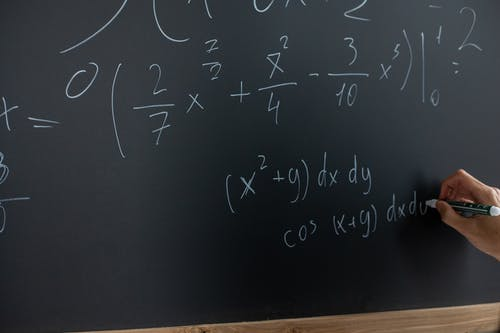 Mathematical Equation Written On Blackboard