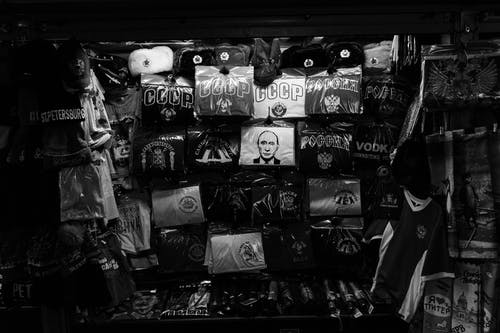 Black and white of pavilion with assorted clothes and goods with russian inscriptions and symbols