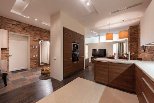 Brown Wooden Kitchen Cabinet Near Kitchen Sink
