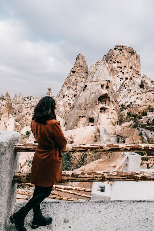 Unrecognizable tourist admiring view of ancient buildings