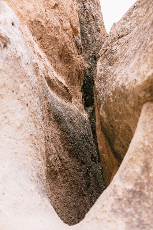 Heavy rough stones in valley in daytime