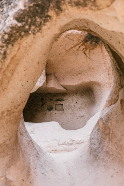 Empty soundless untouched stony cave of dry desert in daytime in wild nature