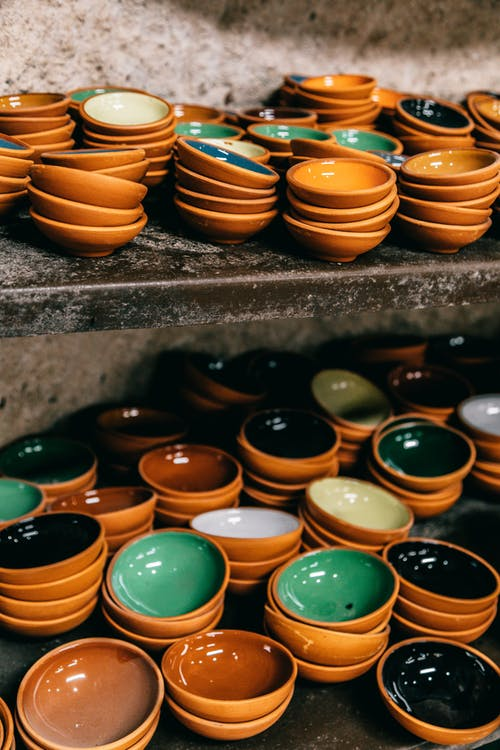 Collection of bright ceramic bowls on shelves