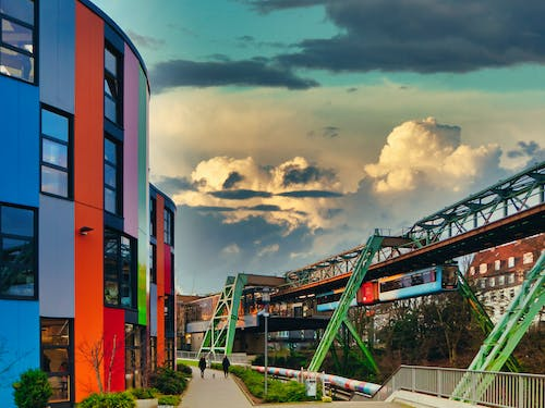 Free stock photo of architectural building, children learning, cloudy sky, colorful