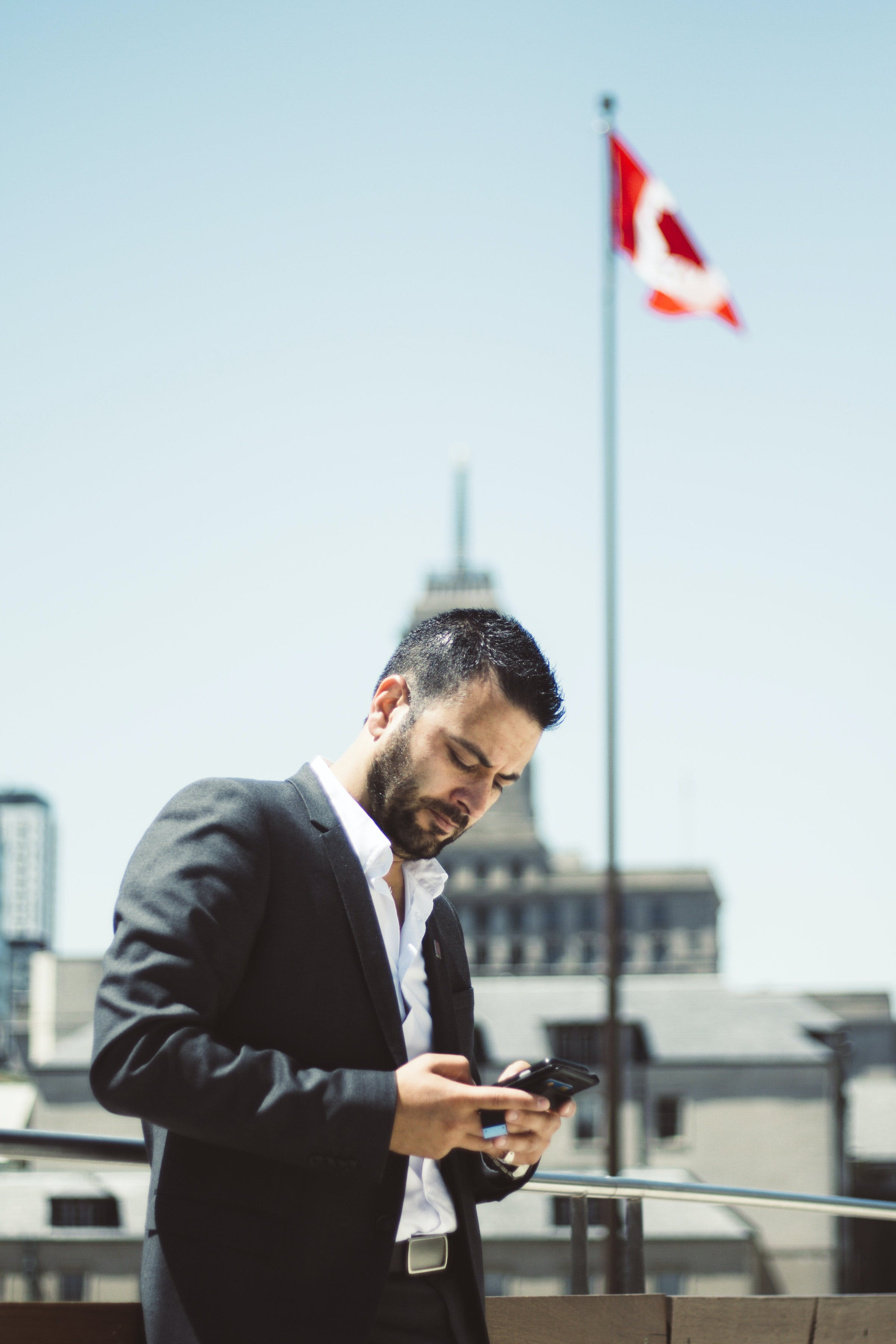 Man in Suit Jacket Holding Phone