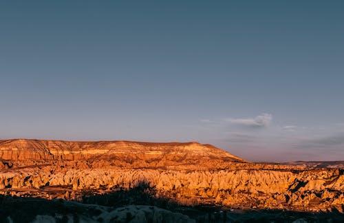 Rocky formations in mountainous terrain under blue sky