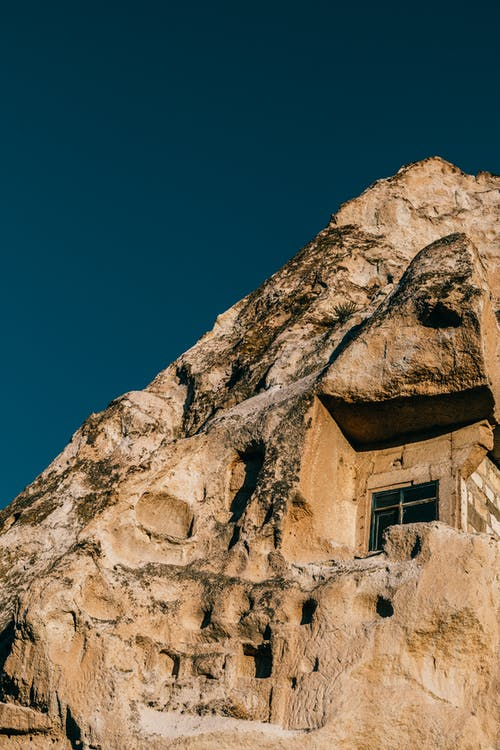 Old rock with window in Cappadocia town