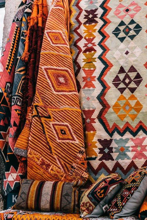 Colorful carpets hanging on wall