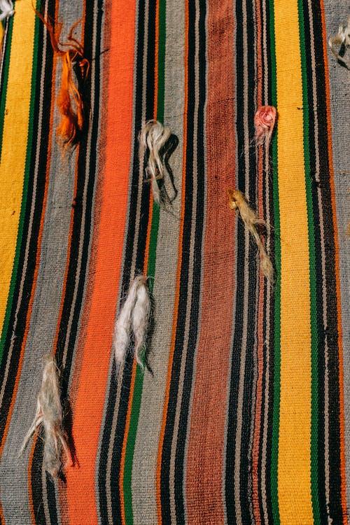 Colorful rug hanging on wall