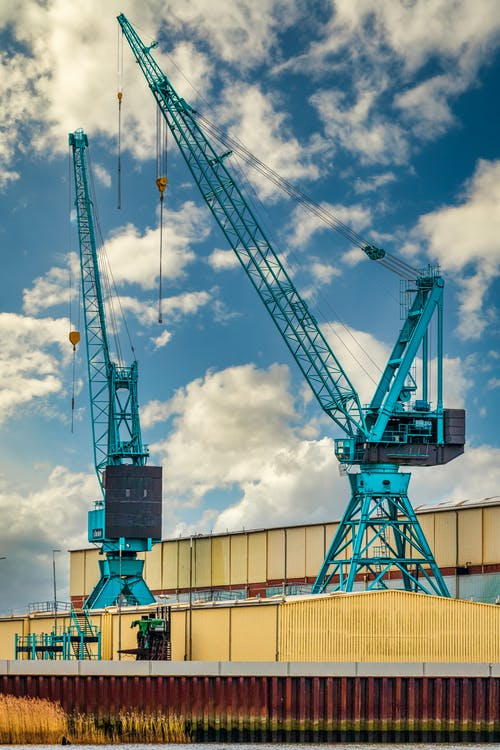 Green and Black Crane Under Blue Sky