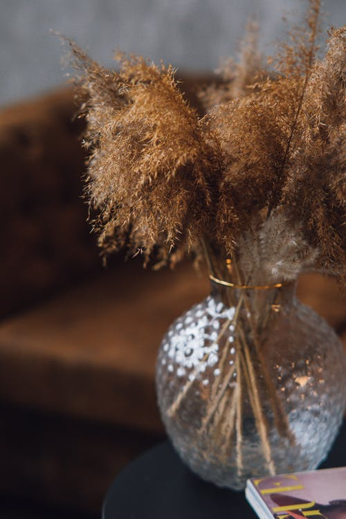 Silver and Gold Decor on Brown Wooden Table