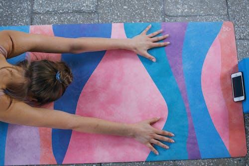 Woman Lying on Pink Mat
