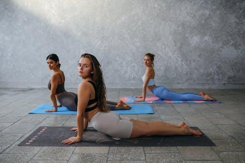 Women Doing a Yoga Pose