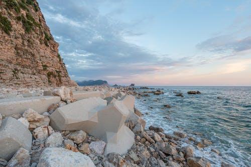 Rocky coast near wavy sea