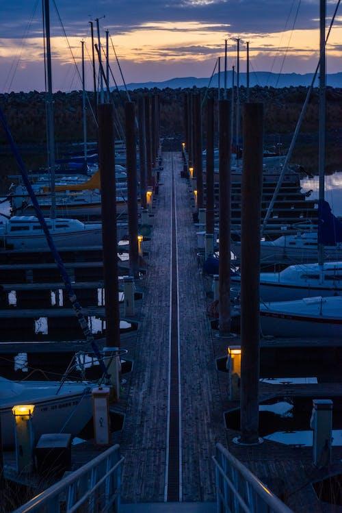 Wooden Jetty on Pier under Evening Sky