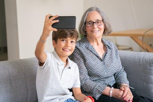 Grandchild Taking a Photo with his Grandma