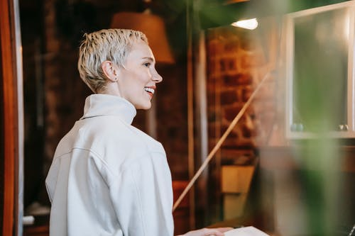 Cheerful woman with stylish haircut smiling
