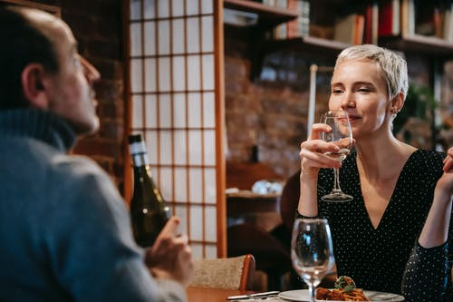 Couple having dinner with wine and food in restaurant