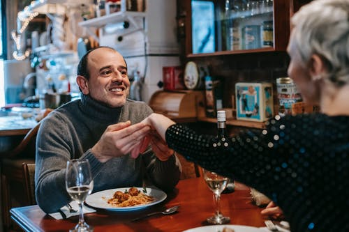 Cheerful couple on date in restaurant