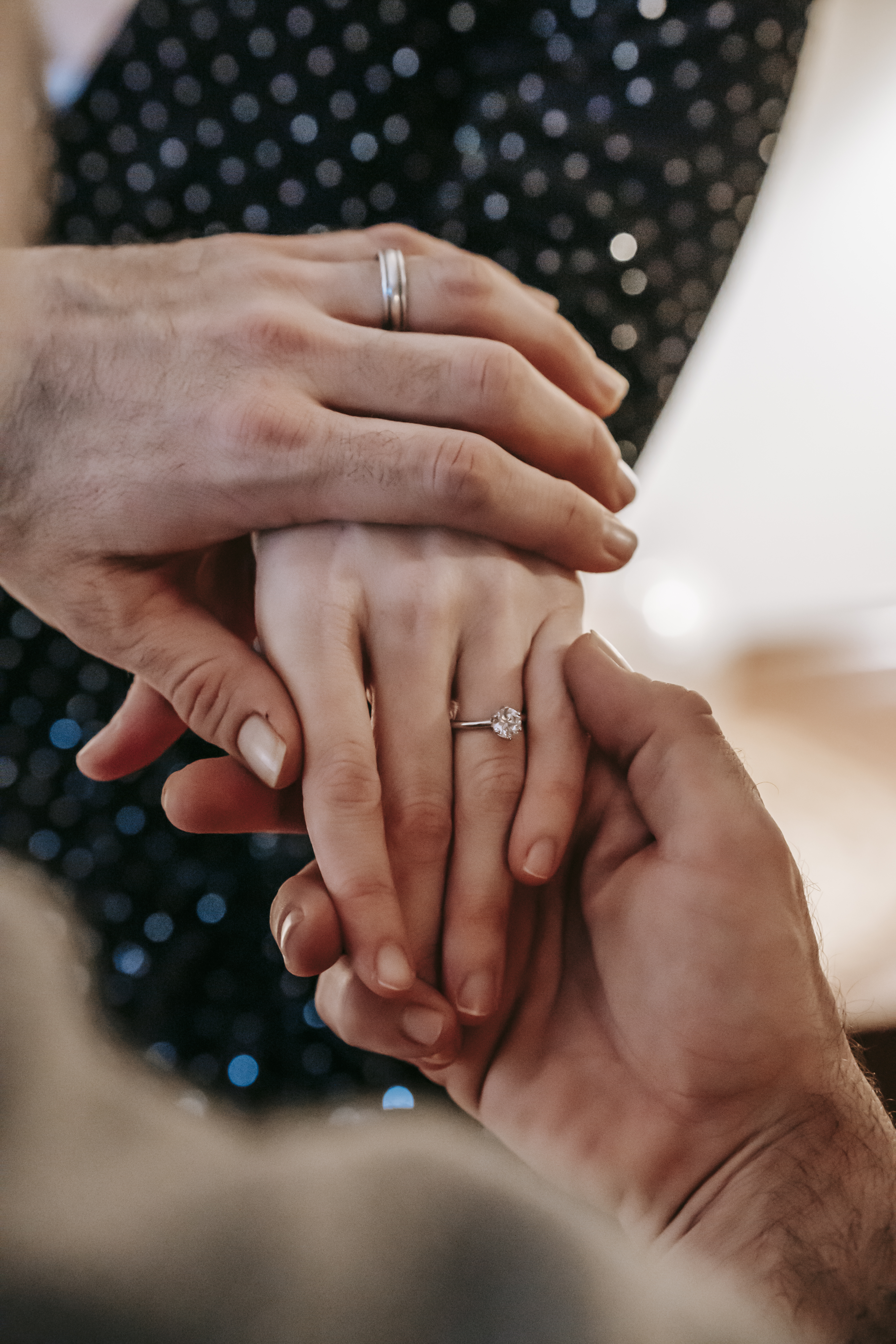 crop man and woman hands with engagement rings