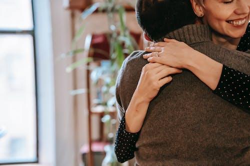 Happy woman embracing husband and enjoying romantic moment