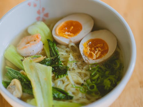 Bowl of noodle soup with boiled eggs