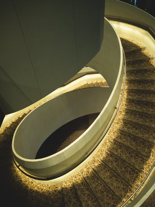 Spiral staircase with ornamental elements in light