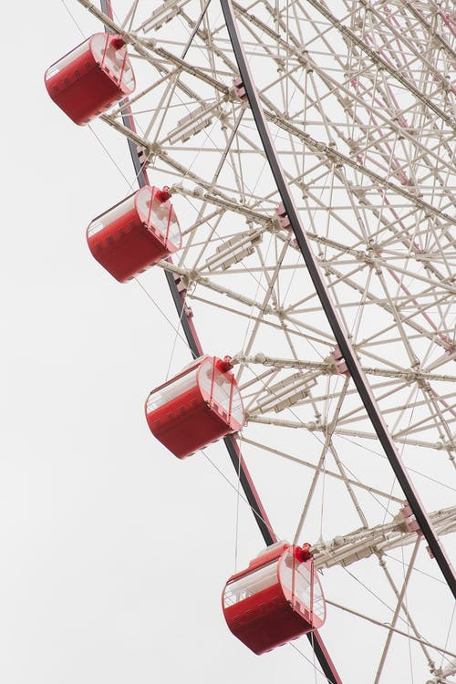 Ferris wheel with passenger cabins in amusement park