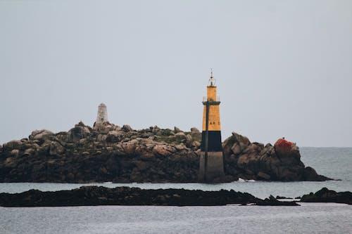 Безкоштовне стокове фото на тему «берег моря, вежа, вечір, вода»