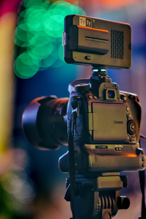 A Close-Up Shot of a DSLR Camera