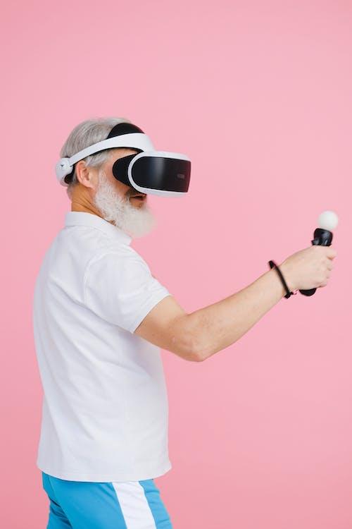 An Elderly Man Wearing a VR Headset
