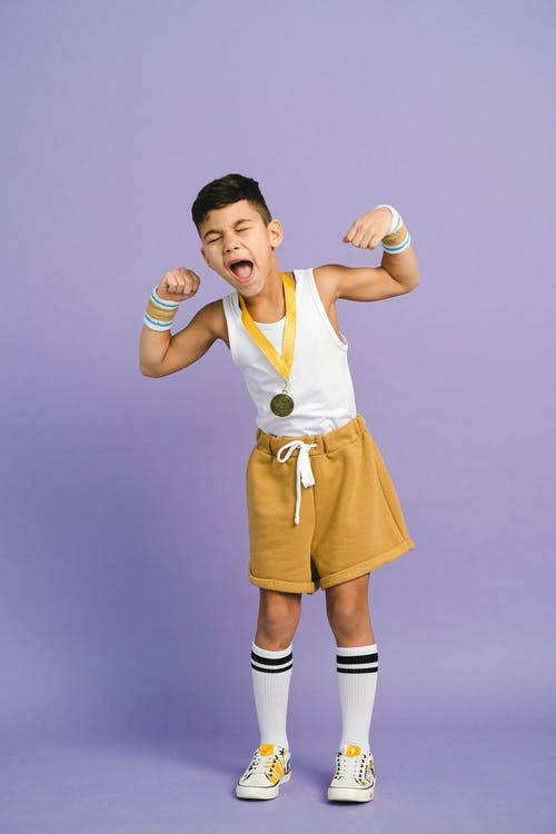 A Boy Wearing a Medal