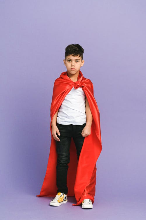 Man in Red Coat and Black Pants
