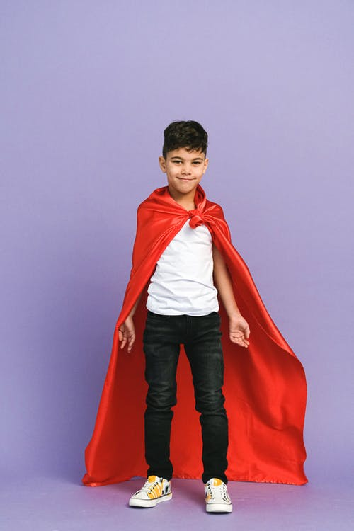 Boy in Red Coat and Blue Denim Jeans