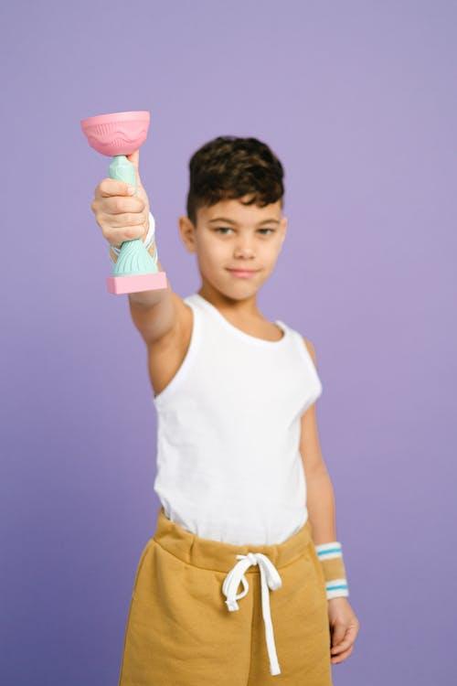 A Boy Holding a Trophy
