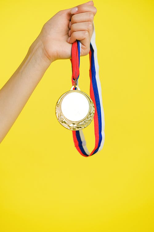 A Person Holding a Medal