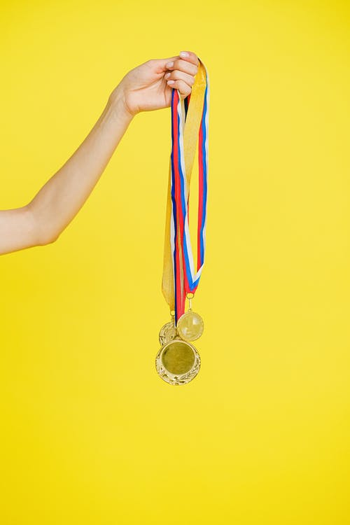 A Person Holding Medals