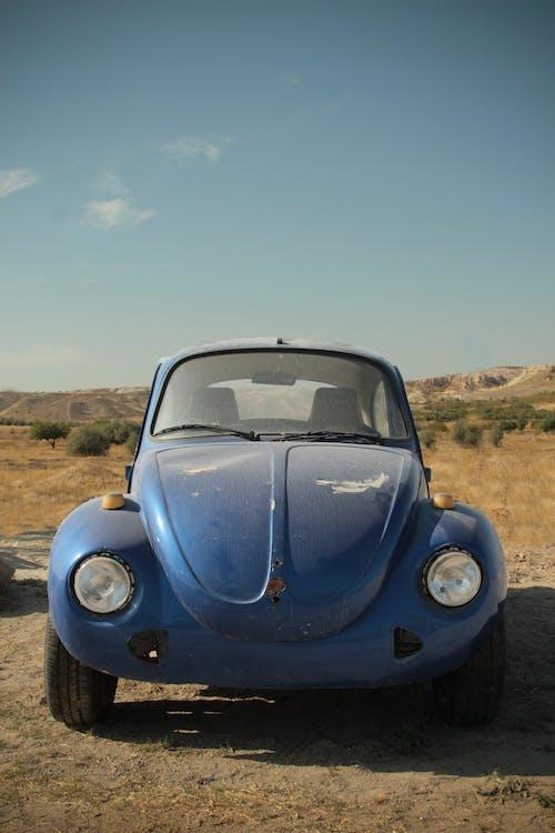 A Blue Volkswagen Beetle