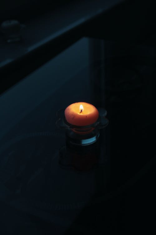 Close-Up Shot of a Lighted Candle