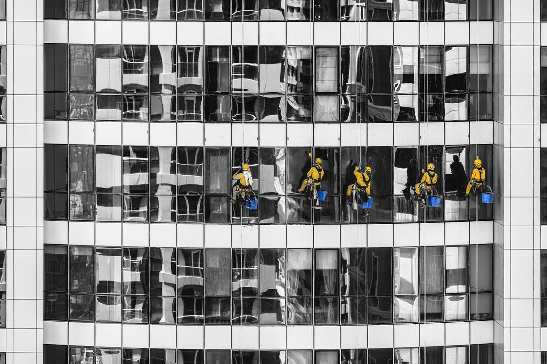 Five Person Cleaning Glass Building