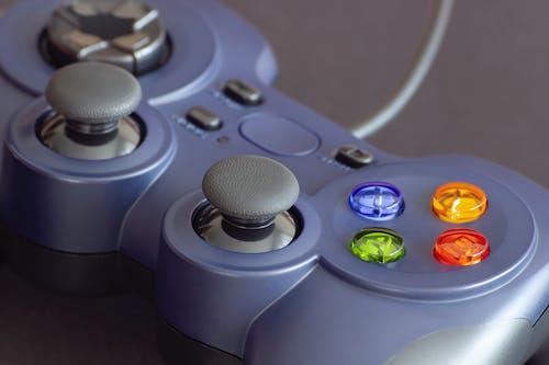 Gray Game Controller on White Textile